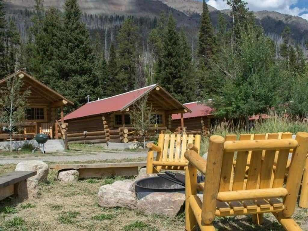 Fire pit view of cabins near yellowstone